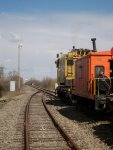 EJ&E Crane 245 with caboose travel west...