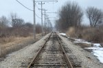 Mainline looking east toward Four Mile Siding.  The beginning of spring inspections and the snow still falls. 3-5-11
