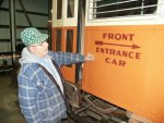 Pete inspects his newly painted sign.