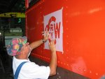 New logo being stenciled to cab