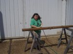 05.17.09 - NEW VOLUNTEER KIM BALETTO IS NEEDLE CHIPPPING THE UPPER DOOR TRACK.