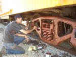 06.28.09 - JOHN BALETTO IS PRIMING THE AR TRUCK WHICH HE HAS NEEDLE CHIPPED AND WIRE WHEELED TO PREPARE IT FOR PAINT.