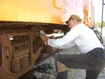"""08.02.09 - VICTOR HUMPHREYS IS WIRE WHEELING THE """"BR"""" TRUCK AFTER NEEDLE CHIPPING TO PREPARE THE TRUCK FOR PRIMER."""