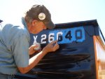 "06.30.10 - BOB KUTELLA IS PAINTING ON THE CAR NUMBER ON THE ""A"" END OF THE CAR."