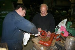 Stu and Bob work on planer parts