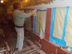 Mark is masking the windows before priming  1-17-15        DSCN1218