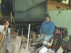 This is Dennis our welder resting a few minutes while working on repairs for the 1630 2-7-15 DSCN1251