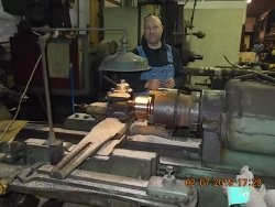 This is Eric Hoyem one of the steam shop machinists working on a new bearing for the 1630's side rod 2-7-15   DSCN1254