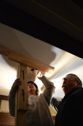 Getting the ceiling panel in place.