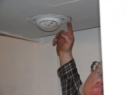 Here Mike seals the edged of the light fixture.
