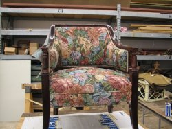 One of two chairs John McKelvey is reupholstering for use in the Lake City.