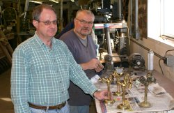 Bill and Keith working on the light fixtures for N.W. El 24 - Photo by Buzz Morisette