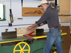 Yours truly running replacement Depot Door panels through the jointer after blade replacement. Photo by Buzz Morisette.