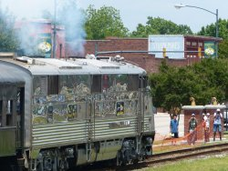 Silver Pilot accelerating away with the North Carolina Transportation Museum's coach train - Photo by Brian LaKemper