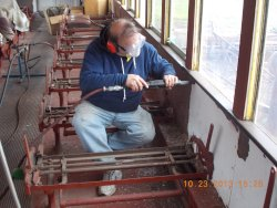 Dave Cook needle chipping one of the last panels below the window line