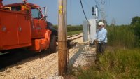 Bob Olson operating electric capstain used to raise transformer.