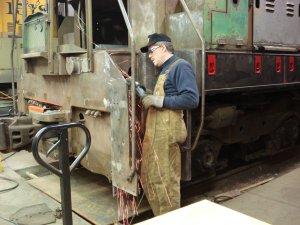 Roger B. grinding welds in step well