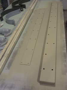 A couple hatch seam covers were primed.