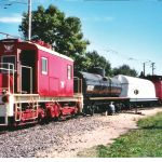 07.10.04 - THE CAR IS BWEING LETTERED BY BOB KUTELLA.  IT SITS IN A TRAIN OF CARS RESTORED THIS YEAR BY THE FREIGHT CAR DEPARTMENT.