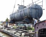10.17.03 - THE TANK IS BEING LOADED ONTO A TRANSPORT TO MOVE IT FROM LAWRENCEVILLE, ILLINOIS TO WASHINGTON, INDIANA FOR RESTORATION.