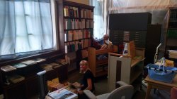 "Volunteers Jan Galayda and Julie Piesciuk sort through the ""for sale"" extra books at the Strahorn Library 08/23/2015."