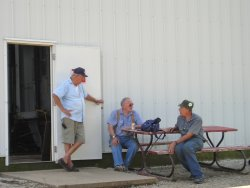 08/11/07 Nick Kallas looks on while Bob Hunter and Bob Kutella discuss primer
