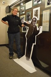 Gwyn poses with a North Shore woman standee in her exhibit