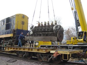 The rare 12 cylinder Winton engine is lifted off the flat car 1st in preparation to unloading the 543. It would be later loaded on IRM's DODX flat car to be taken back to the property.