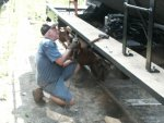 07.27.08 - KIRK WARNER DRILLS A HOLE IN THE LEFT RUNNING BOARD TO ATTACH IT TO THE MOUNTING BRACKETS.